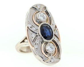 Yellow and white gold sapphire and diamond ring