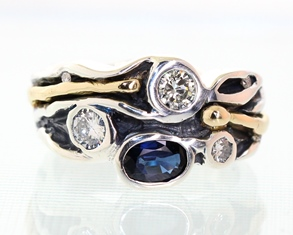 Silver and gold sapphire and diamond ring