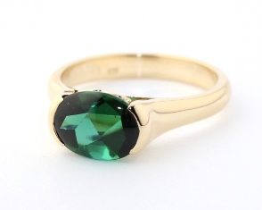 Oval cabochon green tourmaline ring