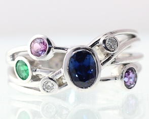 Coloured gems in white gold bands